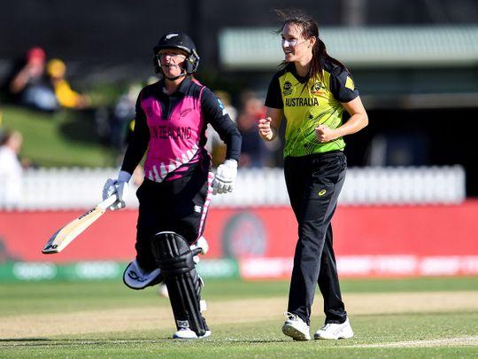 Australia's Megan Schutt (R) celebrates dismissing New Zealand's Hayley Jensen (L) in their Twenty20 women's World Cup cricket match in Melbourne on March 2, 2020.