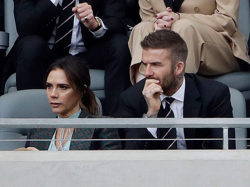 David Beckham watches the match between alongside his wife Victoria