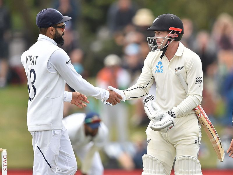 India's captain Virat Kohli (L) congratulates Henry Nicholls as New Zealand win the Test series on day three of the second Test cricket match between New Zealand and India at the Hagley Oval in Christchurch on March 2, 2020. / AFP / PETER PARKS