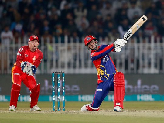 Karachi Kings batsman Alex Hales, right, plays a shot while Islamabad United wicketkeeper Luke Ronchi watches during the Pakistan Super League T20 cricket match against Islamabad United, in Rawalpindi, Pakistan, Sunday, March 1, 2020. (AP Photo