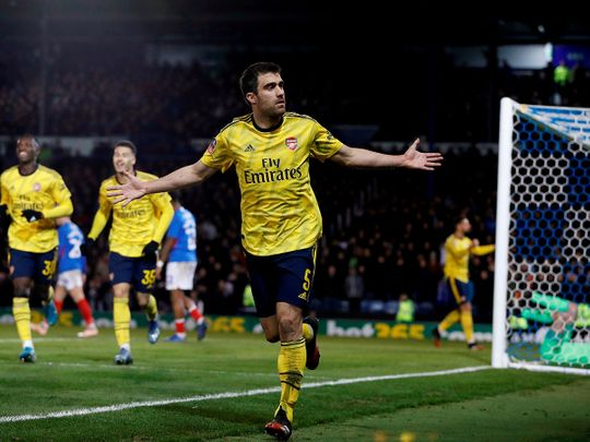 Arsenal's Sokratis Papastathopoulos celebrates scoring their first goal