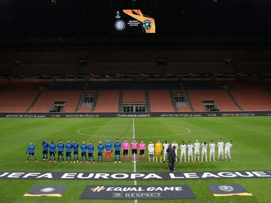 Inter Milan had to play their Europa League match against Ludogorets behind closed doors due to the coronavirusSiro, Milan, Italy - February 27, 2020    The teams line up before the match in an empty stadium after fans were not allowed in over coronavirus fears  Emilio Andreoli/Pool via Reuters