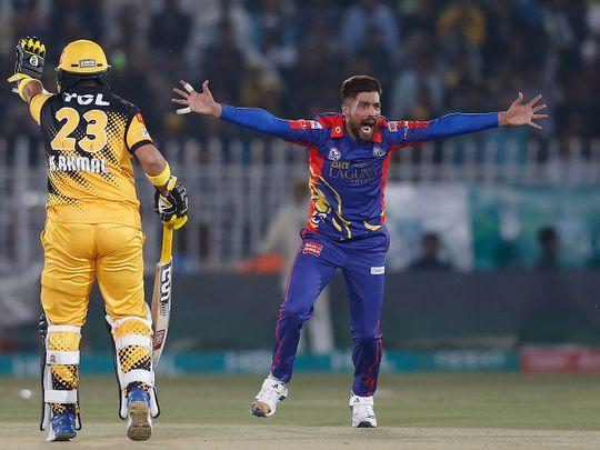 Karachi Kings pacer Mohammad Amir, right, appeals successfully LBW out of Peshawar Zalmi batsman Tom Banton during their Pakistan Super League T20 cricket match in Rawalpindi, Pakistan, Monday