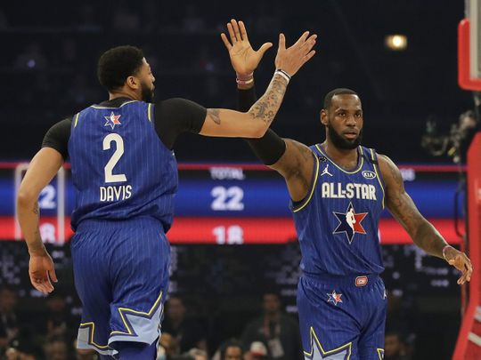 LeBron James of the Los Angeles Lakers high fives Anthony Davis of the Los Angeles Lakers uring the first half of the NBA All-Star basketball game Sunday, Feb. 16, 2020, in Chicago.