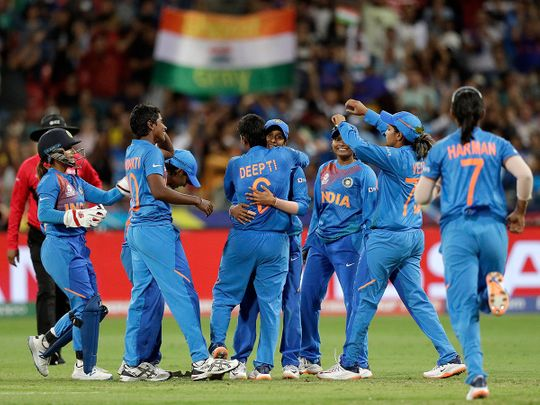The Indian team celebrate the wicket of Australia's Ashleigh Gardner in the first game of the Women's T20 Cricket World Cup in Sydney, Friday, Feb. 21, 2020. (AP Photo/Rick Rycroft)
