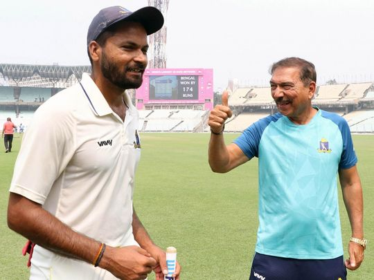 Bengal coach Arun Lal and Mukesh Kumar after Bengal defeated Karnataka by 174 runs to enter their first Ranji Trophy final in 13 years at the Eden Gardens