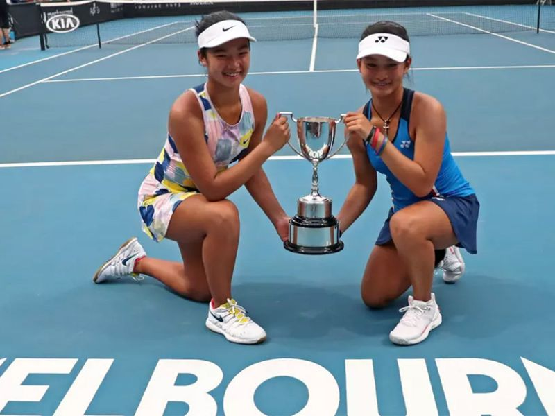 Priska Madelyn Nugroho of Indonesia and her Filipina partner Alexandra Eala with the trophy in Melbourne