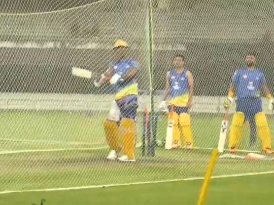 Chennai's MS Dhoni watches his shot sail for a six during a nets session