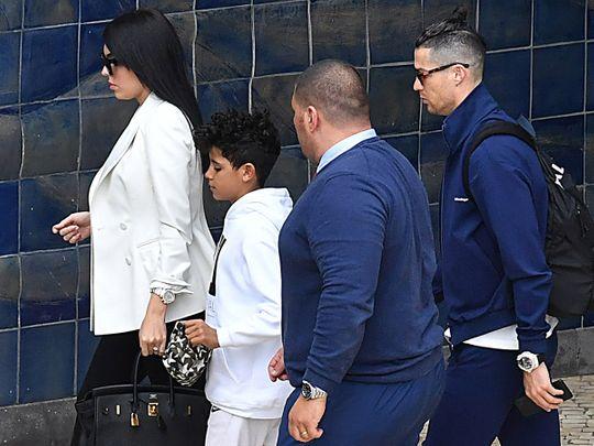 Juventus' Portuguese forward Cristiano Ronaldo (R), his Spanish partner Georgina Rodriguez (L) and his son Cristiano Jr (2ndL) arrive at Madeira airport in Funchal