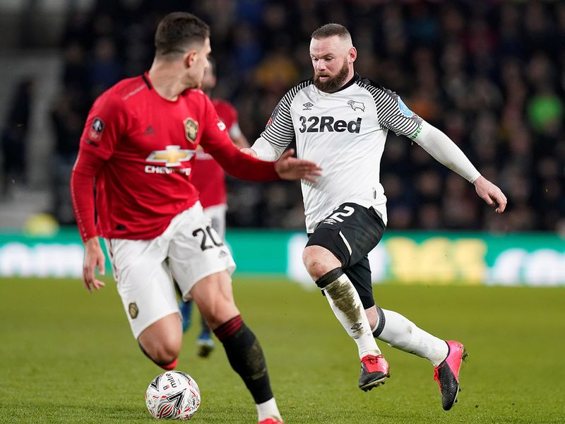 Wayne Rooney in action for Derby County against Manchester United