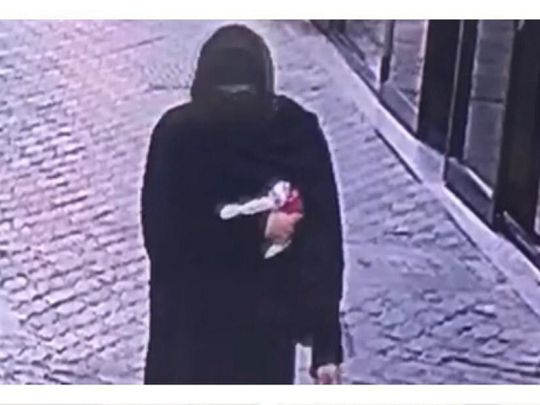 CCTV footage of the thief in women's clothing
