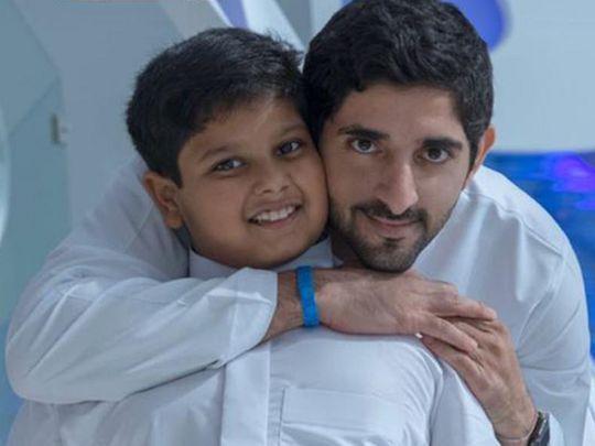 Sheikh Hamdan Bin Mohammad Bin Rashid Al Maktoum with cancer survivor Abdullah Hussain