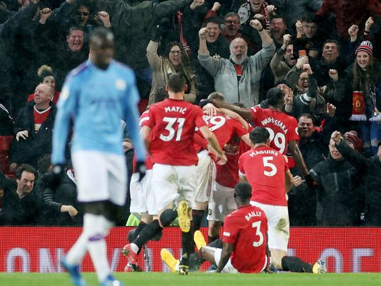 Manchester United celebrate their win over CIty