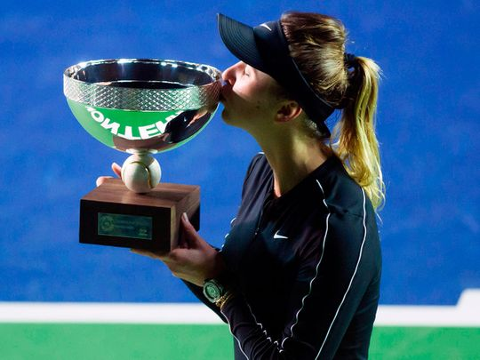 TOPSHOT - Ukraine's tennis player Elina Svitolina kisses the trophy after winning the Monterrey WTA Open women's final singles tennis match against Czech Republic's Marie Bouzkova, in Monterrey, Nuevo Leon State, Mexico on March 8, 2020.  / AFP / Julio Cesar AGUILAR