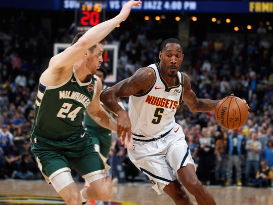 Denver Nuggets forward Will Barton, right, drives to the basket past Milwaukee Bucks guard Pat Connaughton