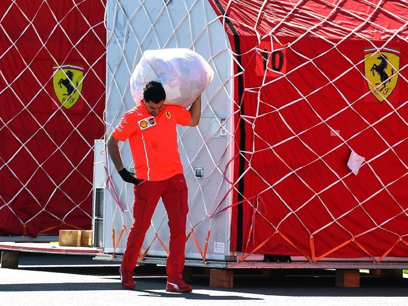 Ferrari unpack equipment at the Albert Park circuit in Melbourne ahead of the Formula One Australian Grand Prix