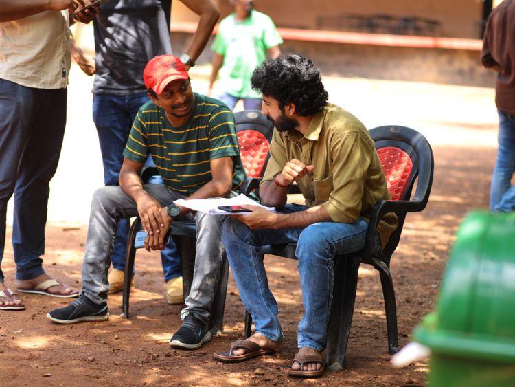 Director Mustafa Mohd with Roshan Mathews on the sets of Kappela (1)-1583935842337