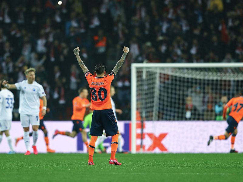 Basaksehir's players celebrate after Edin Visca (unseen) scores a goal during the UEFA Europa league last 32 first leg football match between Basaksehir and FC Copenhagen on March 12, 2020 at the Basaksehir Fatih Terim stadium in Istanbul. / AFP / STRINGER