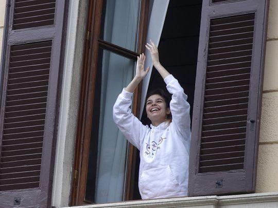 Italians sing out from balconies during coronavirus lockdown