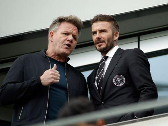David Beckham talks with celebrity chef Gordon Ramsey at an Inter Miami match