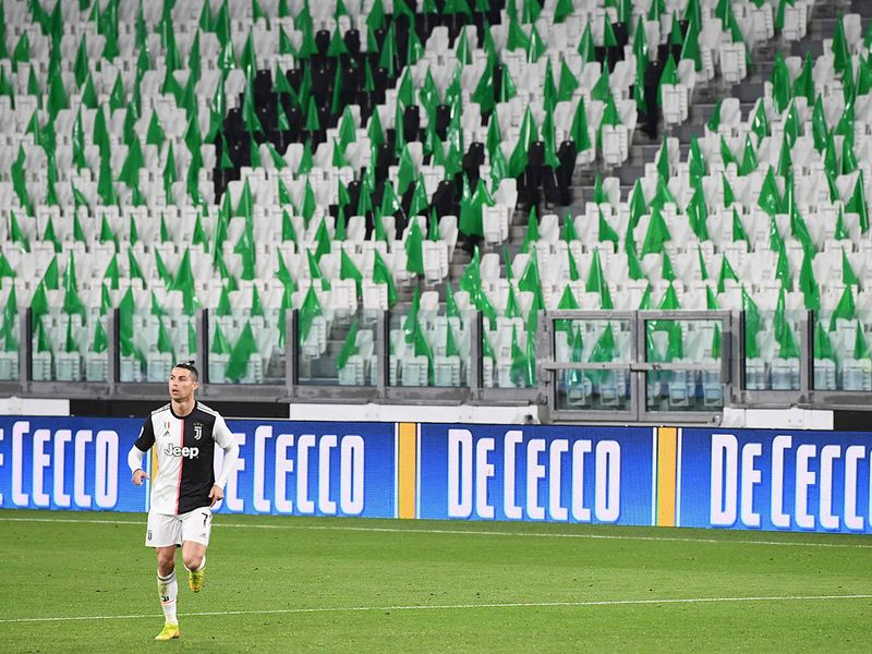 Juventus' Portuguese forward Cristiano Ronaldo runs on the pitch in an empty stadium due to the novel coronavirus outbreak