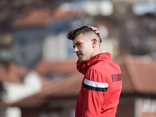 Serbian football player Ilija Ivic, 16, takes part in a training session in Pristina