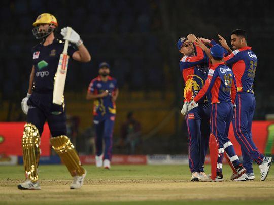 Karachi King's Arshad Iqbal (R) celebrates the wicket of Quetta Gladiators Ben Cutting