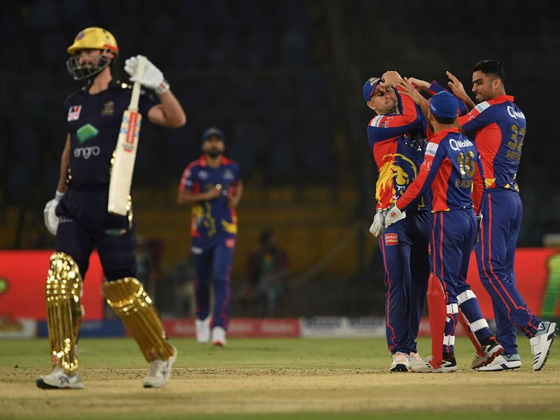 Karachi King's Arshad Iqbal (R) celebrates the wicket of Quetta Gladiators Ben Cutting