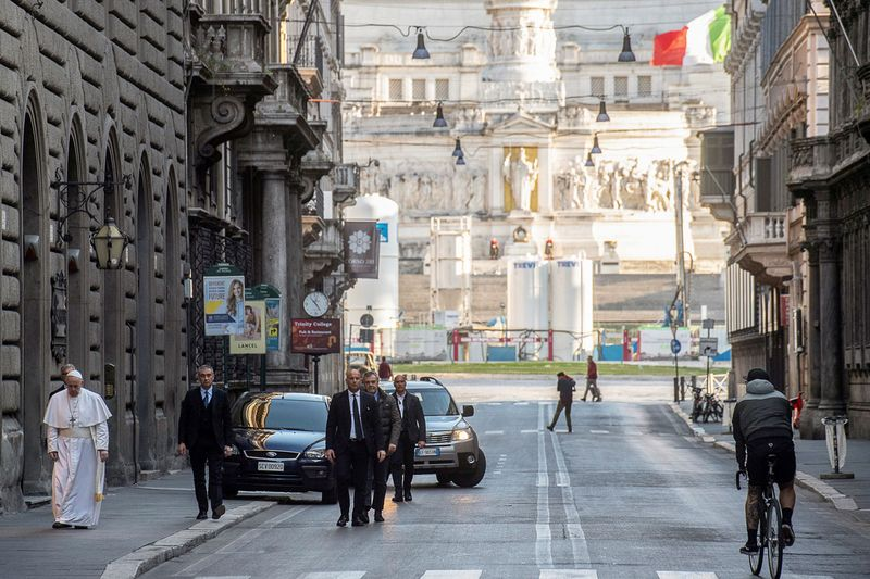 Pope Francis walks in a deserted Rome to pray at two shrines for the end of the coronavirus pandemic, in Rome
