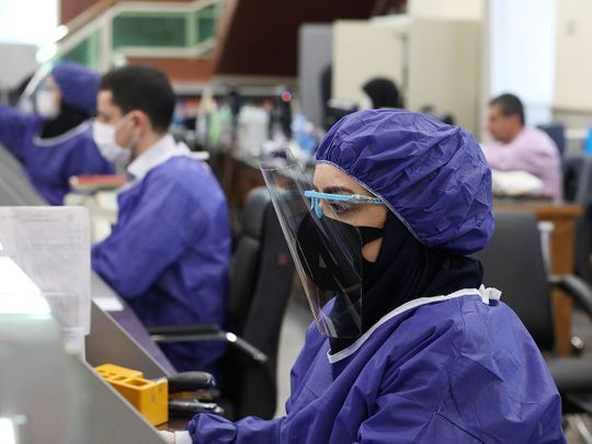 Bank employees wear protective face masks