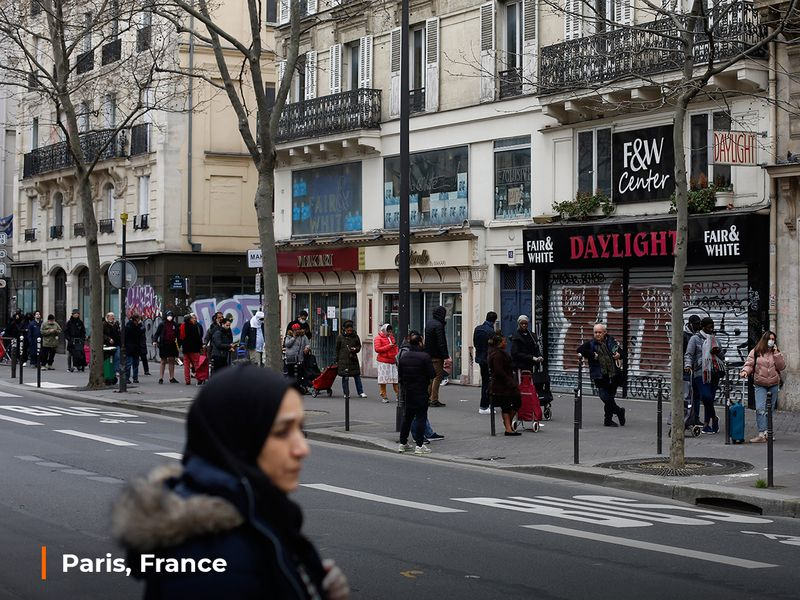 People line up at a supermarket, in Paris