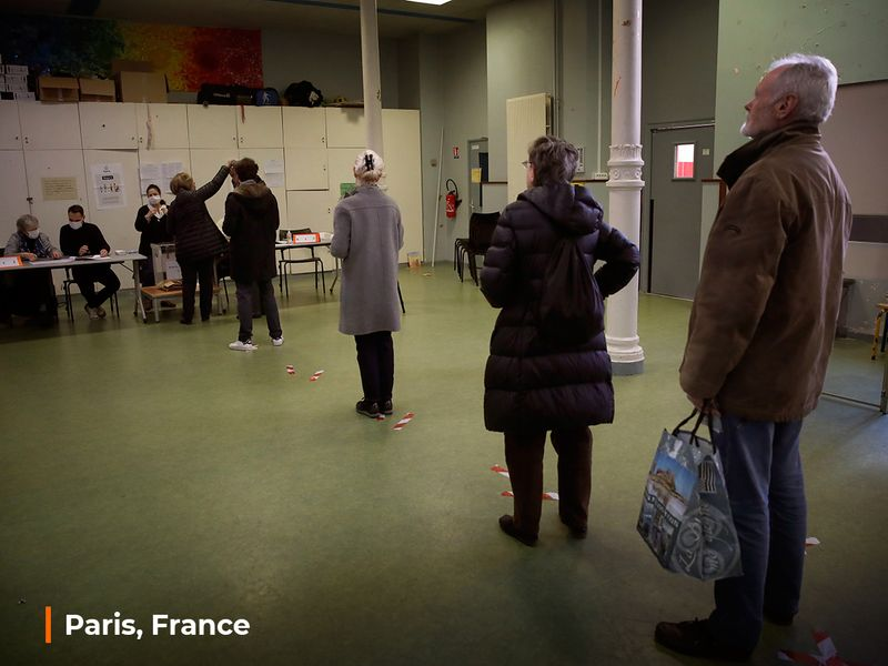 People wait in line to vote for local elections March 15, 2020, in Paris.
