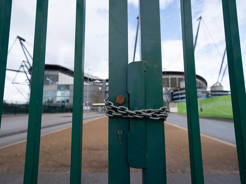The gates at Manchester City's Etihad Stadium remian locked