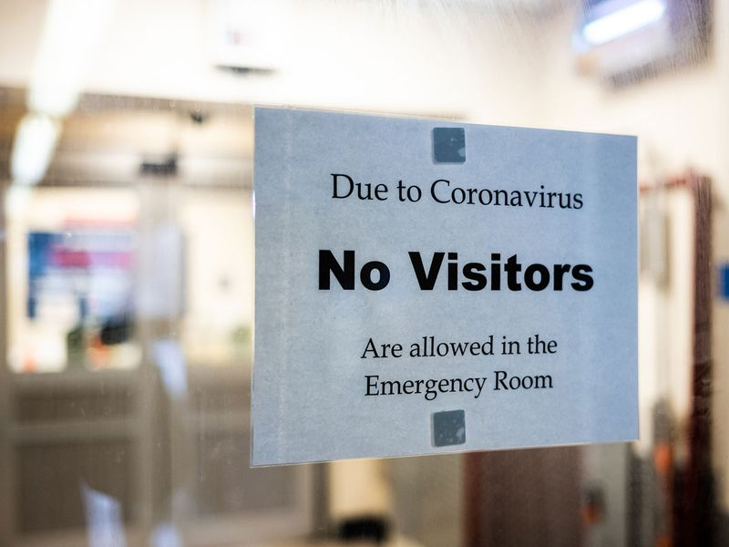 A sign is posted on the door of the Emergency Department at St. Barnabas Hospital in the Bronx borough of New York City.