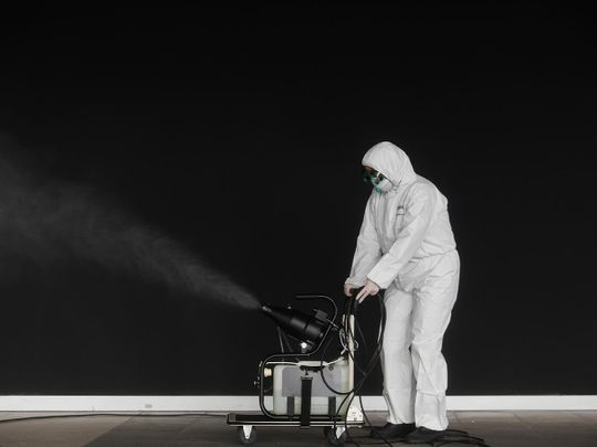 A municipal worker disinfect a warehouse with hospital material, to stop the spread of coronavirus disease (COVID-19) in Cascais, Portugal March 27, 2020.