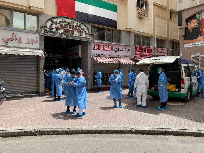 Several medical staff were seen outside apartment blocks in Naif, Dubai on Saturday