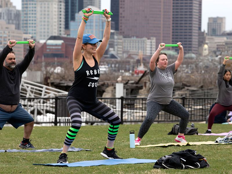People in an exercise group keep their distance during a session in Piers Park in Boston, US.  The group usually meets at the YMCA which is closed due to concern about the coronavirus.