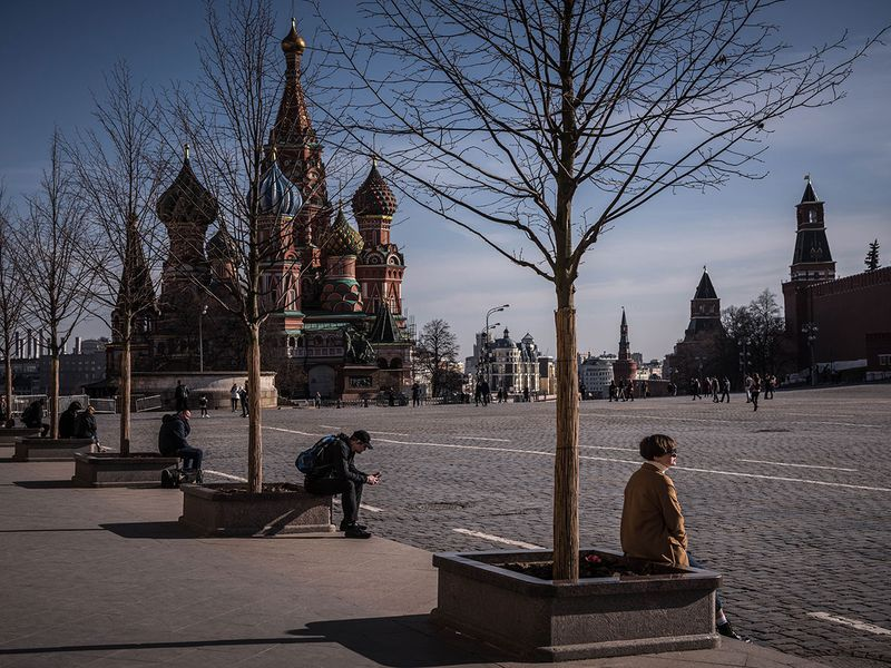 People sit at a safe distance in Red Square in Moscow.