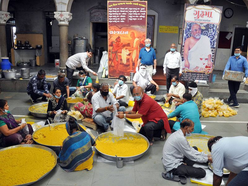 Jain community members in Surat pack food for distributing to needy people during a 21-day lockdown in India.