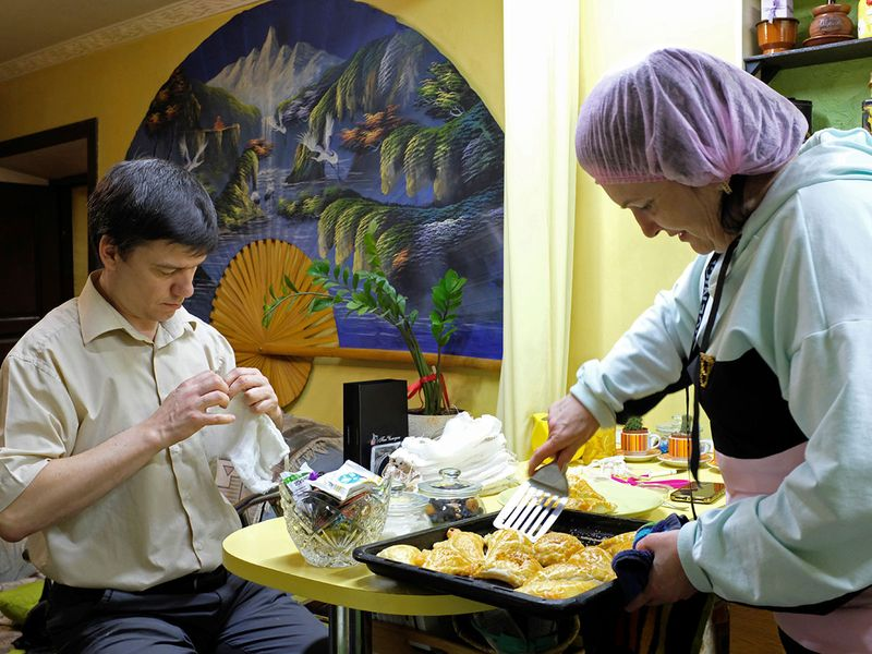 Liliya Nesenyuk and Nikolai Naydyonov, volunteers from a support group for people with visual and hearing impairments, sew protective face masks and cook food for the homeless and people in need, as the spread of coronavirus disease (COVID-19) continues, in Stavropol, Russia.