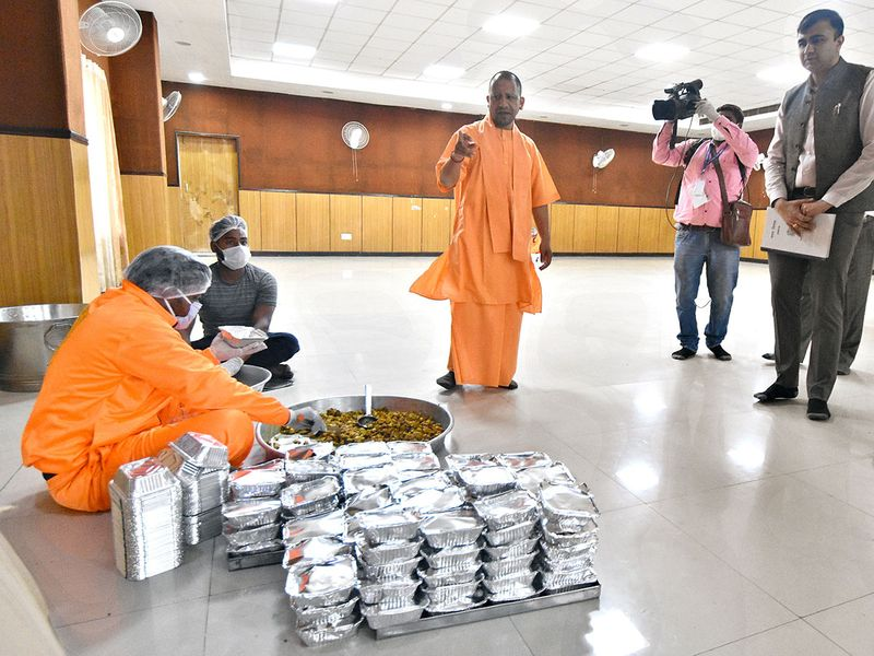 Uttar Pradesh Chief Minister Yogi Adityanath inspects a community kitchen made to feed the homeless and poor people in Lucknow, during the lockdown announced for the entire country.