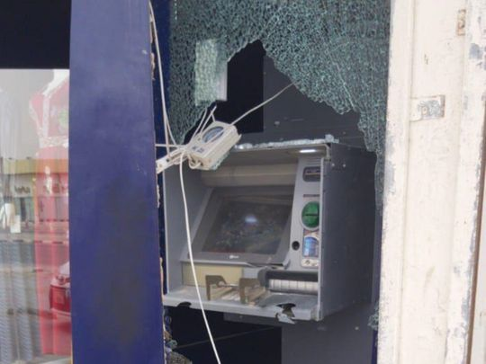 Police pictures of damaged cash machine in Ajman