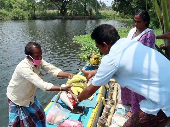 Kerala boatman sells food during coronavirus