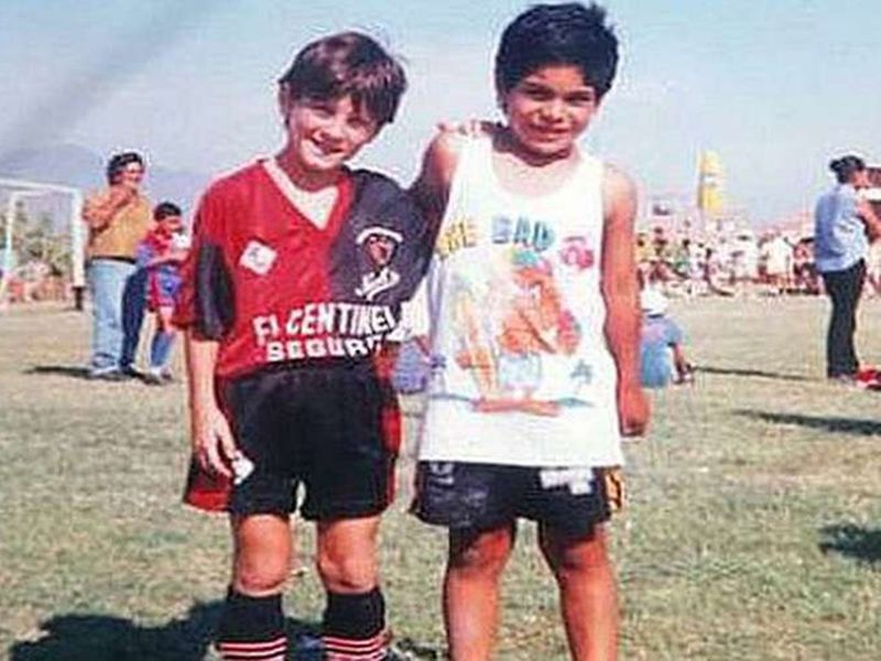 A young Lionel Messi, left
