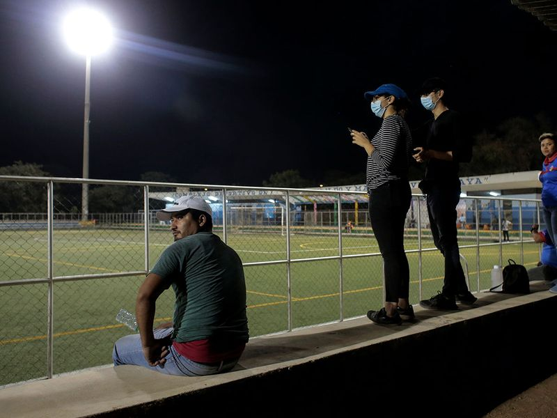 Spectators wearing a face mask are pictured during the soccer match Juventus Managua vs Diriangen FC, while in the rest of the world the activities were suspended following the outbreak of the coronavirus disease in Masaya, Nicaragua.
