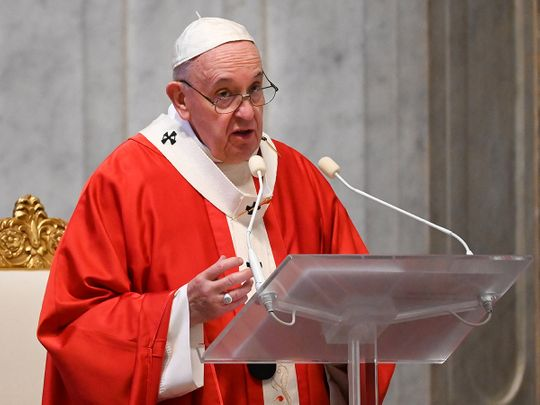 Pope Francis speaks as he leads Palm Sunday mass in St Peter's Basilica without public participation due to the spread of coronavirus