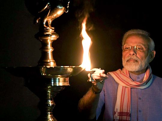 Prime Minister Narendra Modi lights a lamp