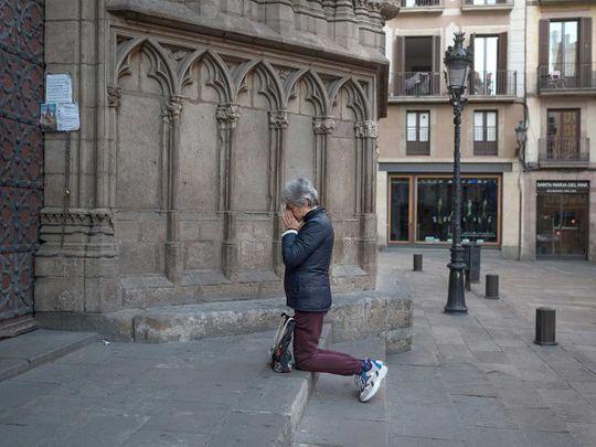 Spain woman prays lockdown