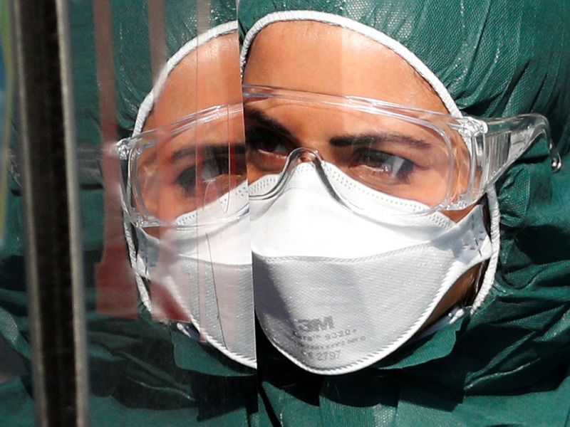 A medical worker in a protective suit arrives at the Policlinico Tor Vergata hospital, where patients suffering from coronavirus disease (COVID-19) are being treated, in Rome, Italy