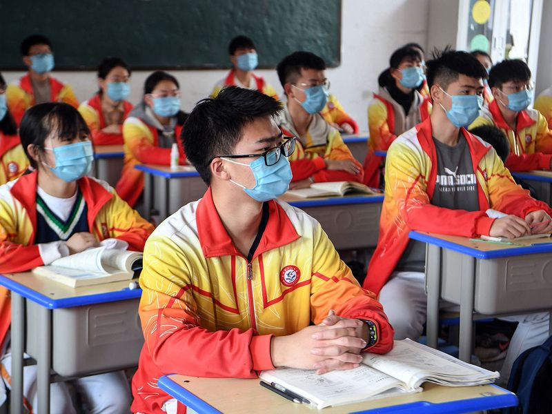 High school grade three students wearing face masks attend a class after the term opening was delayed due to the COVID-19 outbreak, in Bozhou in China's eastern Anhui province.